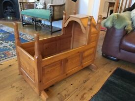 Old solid pine babies cot.