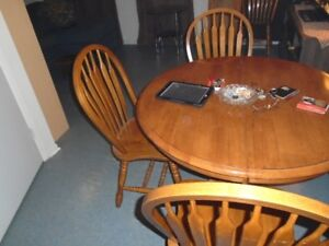 Kitchen table with  4 chairs and a hutch