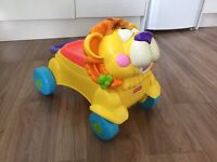 Fisher-Price ride on lion and walker