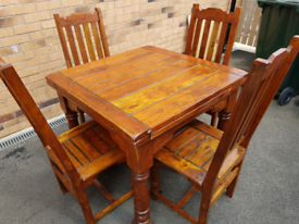 Solid oak extendable dining table and 4 matching chairs