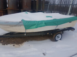 2 boats and 2 trailers....one 55 HP Chrysler...1300$