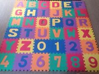 Alphabet and numbers puzzle mat