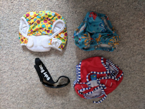 Infant swim diapers + Baby Banz sunglasses