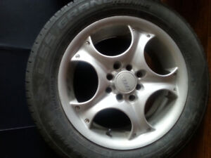 185 60 r15 tires on alloy fancy rims. from toyota yaris