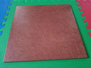 Brand new 18x18 brown leather grain porcelain tile