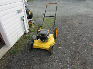 CRAFTSMAN LAWN MOWER WITH LARGE REAR WHEELS