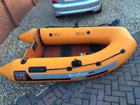 Inflatable dinghy and pump