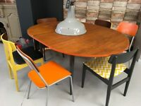 Vintage 1960s/70's extending dining table with a mix match of retro chairs