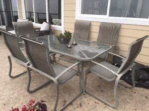 Outdoor metal patio set with 6 chairs.