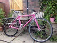Bright pink fixed gear bike