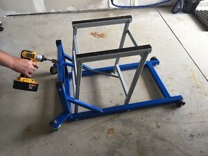 Heavy duty motorcycle lift holds Harley decker