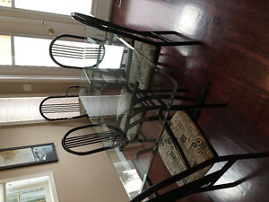 Glass top dining table with 6 chairs. Must go by Monday morning!