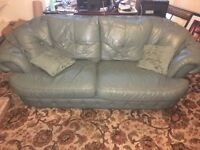 Green leather 3 seater, 2 seater and foot stool