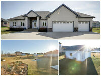 Welcome Home! Acreage w/ city water, 5 beds, extra garage + more