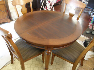 Like new Hard wood Table and Chairs