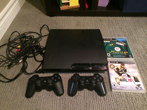 PS3 console with two controllers and 1 game London Ontario image 1