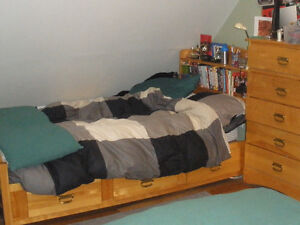 2 solid maple twin captains beds