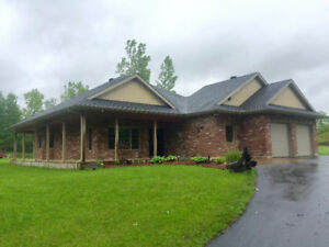 CONTEMPORARY OPEN CONCEPT BUNGALOW ON 1.69 ACRE LOT ON KING'S RD