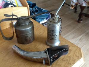 Two oil cans and one oil can spout
