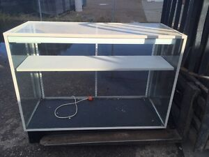 Glass display cases and a stand. 2 light up.