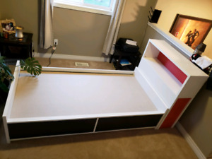 Kids bed with headboard and drawers with a hidden book shelf