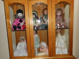 9 China Dolls with display cabinet