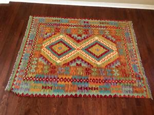 Handmade Chobi kilim rug.