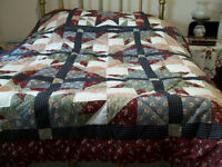 two matching patchwork quilts with 2 pillow shams