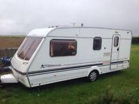 2001 Swift Charisma 560 4 berth touring caravan, end washroom