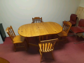Heavy pinewood drop leaf dining room table and 4 chairs £75