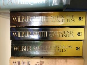 REDUCED - WILBUR SMITH - WHEN THE LION FEEDS TRILOGY