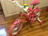 "Kids bike - Girls pink Honey bike with stabilisers 14"" in excellent and clean condition"