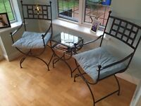 Wrought iron chairs and coffee table.