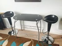 Breakfast table and stools