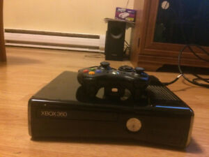 Black xbox 360 and one controller