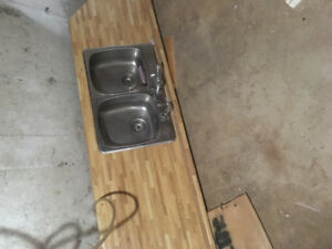 Counter top with double sink and faucets