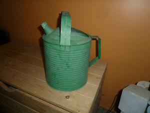 Antique green watering can