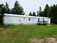 NEW PRICE!!!  40 ACRES! 2 BR HOME! GARAGE! BUNKIE! WOODSHED!