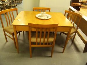 CIRCA 1950 MAPLE TABLE AND FOUR MAPLE CHAIRS