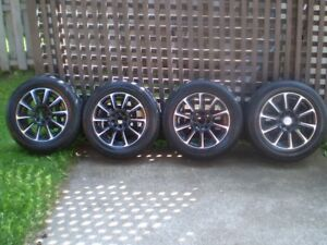 4 - P205-60R-15 TIRES ( M+S) ON UNIVERSAL CUSTOM MAG RIMS
