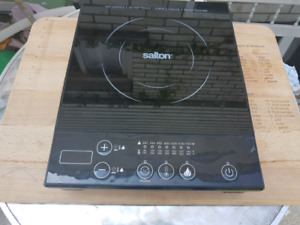 Salton Portable Induction Cooktop with cutting board.