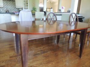 Solid Birch table and 6 chairs (2 square back and 2 round back)