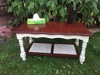 Cream and mahogany coffee table
