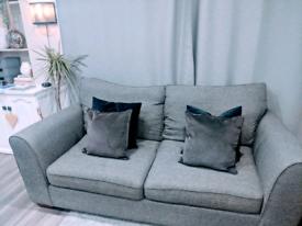Two 3 seater grey fabric sofas. Furniture Village