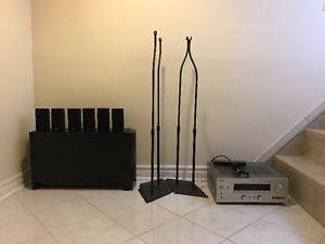 BOSE SURROUND SOUND WITH YAMAHA RECEIVER AND SPEAKER STANDS.