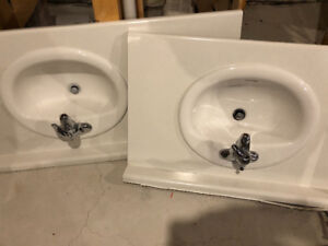 Moen adler faucet with white oval sink