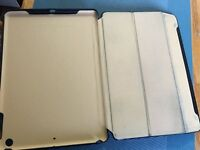 Used Ipad Air high taste. Precision made genuine leather case