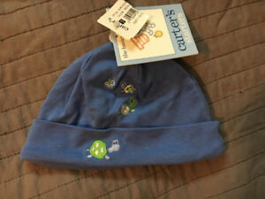 Newborn sized hat with embroidered turtles and butterfly