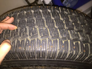 Two Studded Winter Tires 235/75 R15 1080
