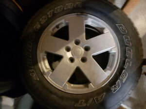 Tires and rims off a Jeep 255 70 18s